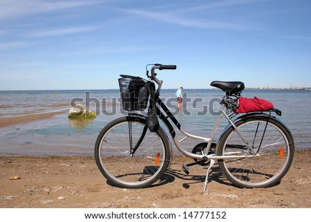 Pleasant bicycle walk along The Baltic Sea - stock photo