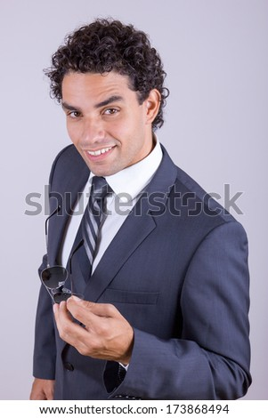 pleasant businessman in suit with glasess smiling - stock photo