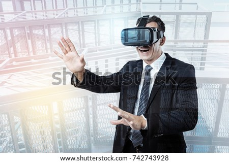 Pleasant confident businessman testing virtual reality