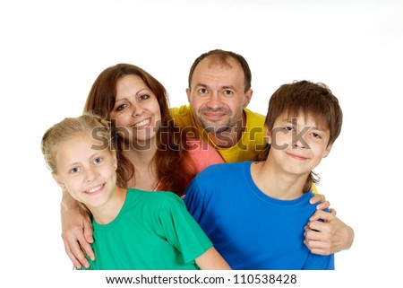 Pleasant family of four in bright T-shirt on a white background - stock photo