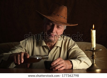 Pleasant man sits quietly at his home at the table - stock photo