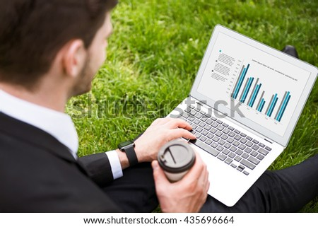 Pleasant man working on the laptop