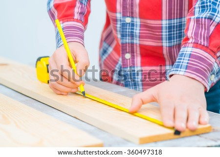 Pleasant man   working with wood  - stock photo