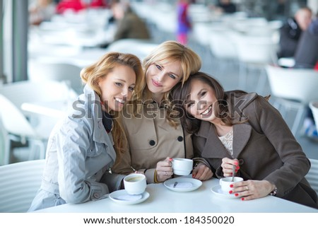 Pleasant meeting in the small coffee shop - stock photo