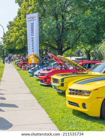 PLEASANT RIDGE, MI/USA - AUGUST 16, 2014: Eleven Chevrolet Camaro cars at Camaro Corral, at the Woodward Dream Cruise, the world's largest one-day automotive event. National Scenic Byway. - stock photo