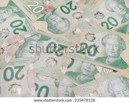 PLEASANT VALLEY, CANADA - NOVEMBER 30, 2014: The Canadian twenty dollar note is a banknote of the Canadian dollar. The Frontier Series banknote was released in 2012. - stock photo
