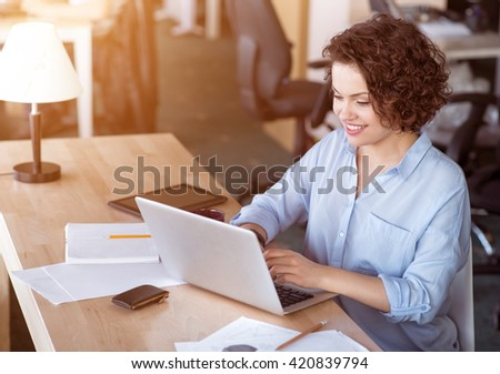 Pleasant  woman using laptop