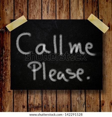 Please call me noteon message note with wooden background - stock photo