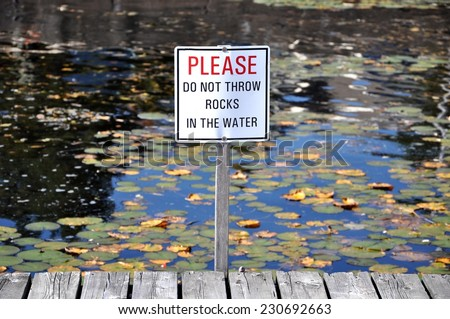 Please do not throw rocks in the water sign