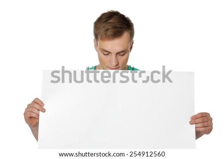 Please use this paper to write your message. Young man holding white empty paper isolated on white background.