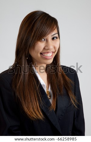 Pleased Asian woman in tux coat - stock photo