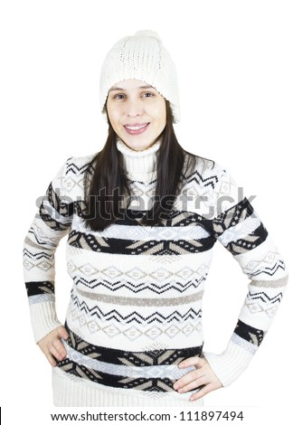 Pleased girl in warm winter sweater and hat isolated on white - stock photo