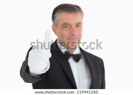 Pleased waiter having thumbs up in front of camera