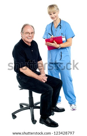 Pleasing doctor collecting patient's health history before annual check up.