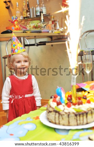 Pleasure and happiness of  little girl on birthday