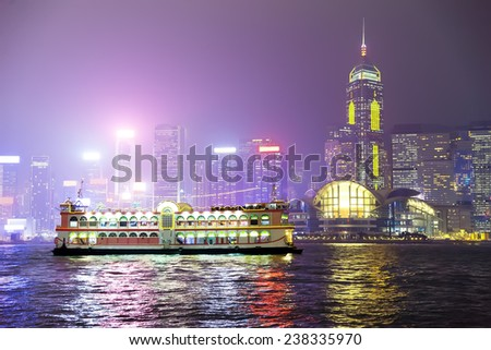 Pleasure boat on the night of Hong Kong. China - stock photo
