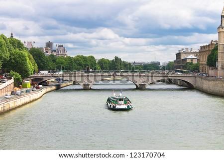 Pleasure boat on the Seine in Paris. France - stock photo