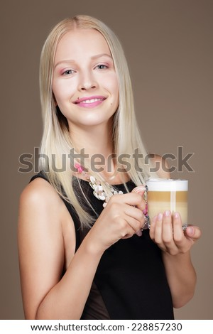 Pleasure. Woman Blonde holding Cup of Morning Coffee - stock photo