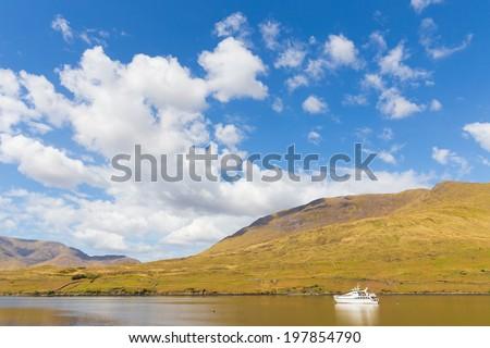 Pleasure yacht in Killary Harbour - stock photo