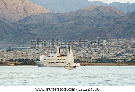Pleasure yachts at the gulf of Aqaba near a border of Jordan-Israel - stock photo
