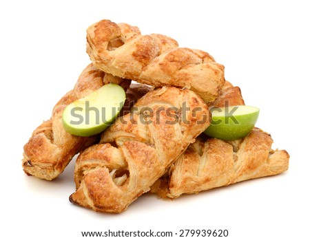 plenty of apple pie and green apple slices on white background  - stock photo