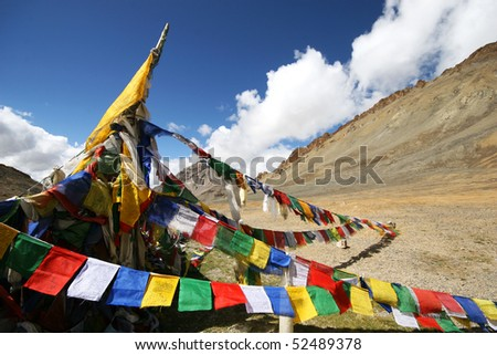 Plenty of colorful Buddhist prayer flags on the road between Leh and Manali - stock photo