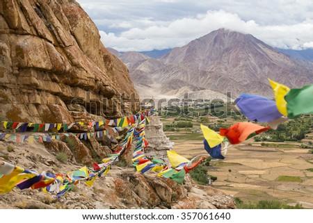 Plenty of colorful Buddhist prayer flags on the Stupa near Takthok gompa, Buddhist monastery in Ladakh, Jammu Kashmir, India - stock photo