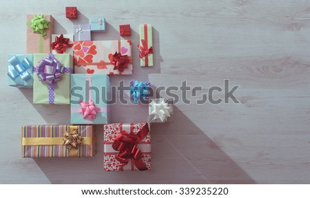 Plenty of colorful gifts on a wooden table top view , blank copy space, celebration and Christmas concept - stock photo