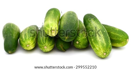 plenty of green cucumbers on white background