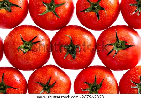 Plenty of Healthy Fresh Red Tomatoes with Water Drops in a Pattern, Isolated on a White Background, Can be Used for Backgrounds. - stock photo