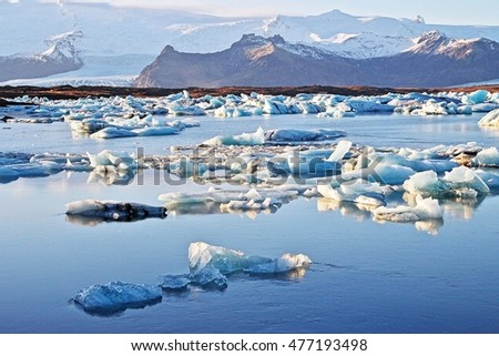 Plenty of ice both in the water and glacier on the mountain in Iceland / Ice Land