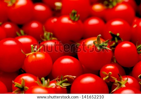 plenty of little red cherry tomatoes - food background - stock photo