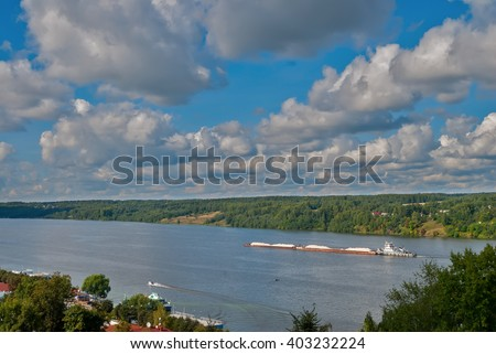 Ples, Russia - August 30, 2009: Barge moving in the waterways on Volga river - stock photo