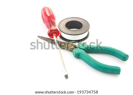 pliers and screwdriver on a white background
