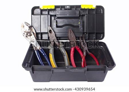 pliers in plastic box. - stock photo