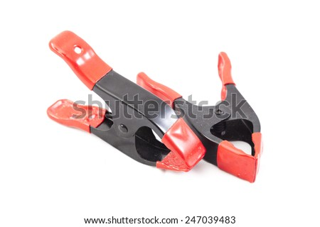 Pliers on a white background Made of metal with red leather grip.