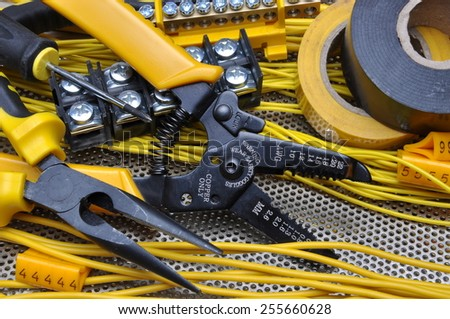 Pliers strippers with electrical component kit  - stock photo