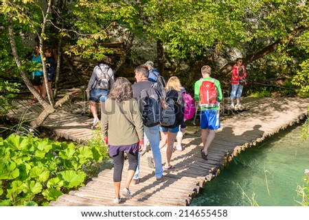 PLITVICE LAKE NATIONAL PARK, CROATIA - AUG 19, 2014: Unidentified people walk in the Plitvice Lakes National Park, which is a UNESCO World Heritage site