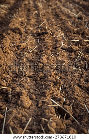 Ploughed field, soil close up, agricultural background - stock photo