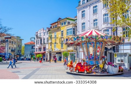 PLOVDIV, BULGARIA, APRIL 7, 2015: The main square in bulgarian city plovdiv is especially marvelous when combining picturesque buildings, magnificent fountain and majestic looking new town hall.