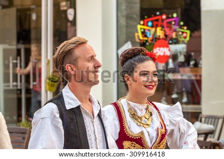 PLOVDIV, BULGARIA - AUGUST 06, 2015 - 21-st international folklore festival in Plovdiv, Bulgaria. The folklore group from Serbia dressed in traditional clothing is preforming Serbian national dances.