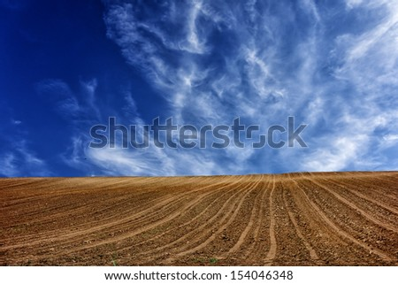 plow with cloud - stock photo