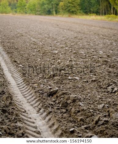 Plowed field, furrows - stock photo