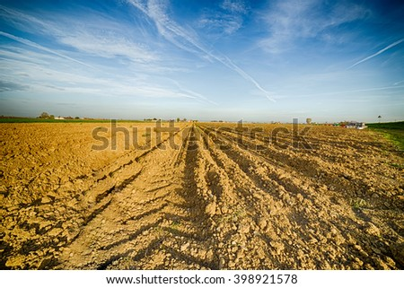 plowed potato field after harvest in the plains of Emilia Romagna in the countryside in Italy