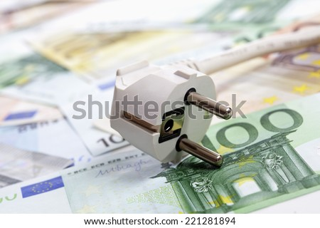 Plug and euro notes, close up - stock photo