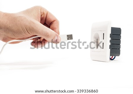 Plug in. A man stabs a usb plug into a usb port