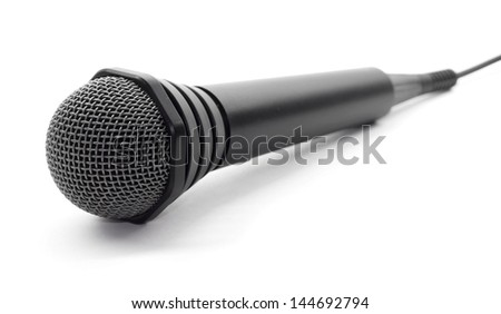 Plugged in black microphone on white background