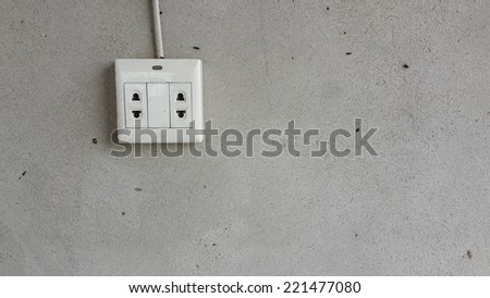 Plugs on wall - stock photo