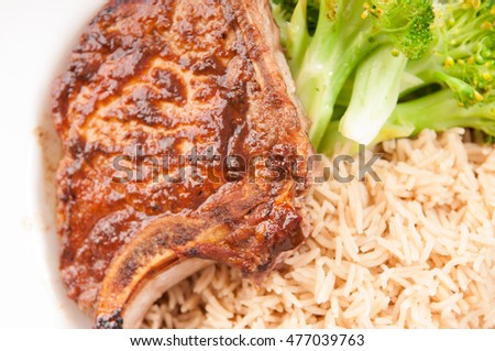 plum bbq sauce pork chop with broccoli and steamed brown rice