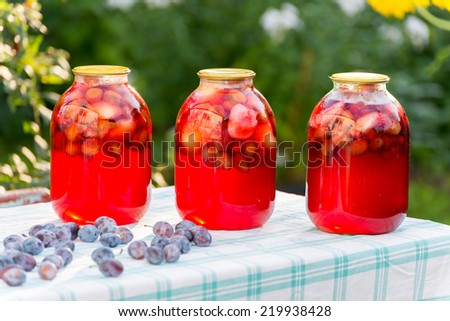 Plum compote home canning in the garden - stock photo